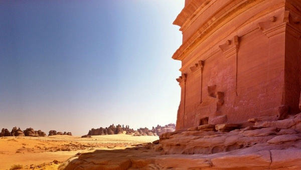 The Qasr Al-Farid Tomb in Madain Saleh looking across the plain of alien rock formations.