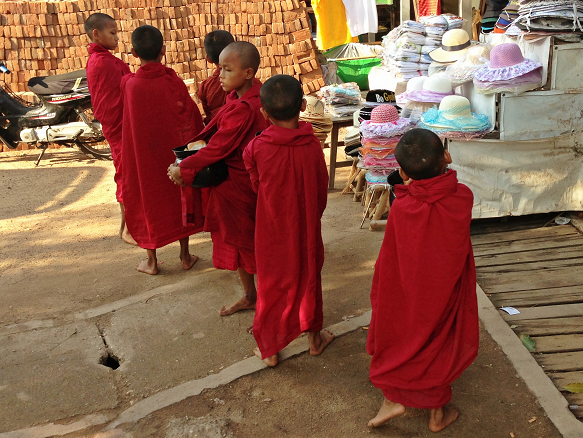 Little Monks in training in Old Bagan.  This will be their only meal of the day.