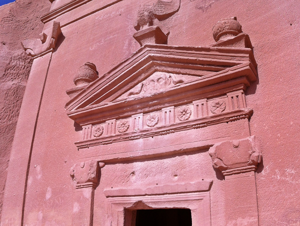 In Madain Saleh, roses above doors symbolize plates that collected blood from sacrifices